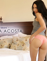 Araya Acosta rubs herself in her soft bed