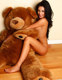Stunning perfect Alluring Vixen babe Danielle gets naked with her giant teddy bear