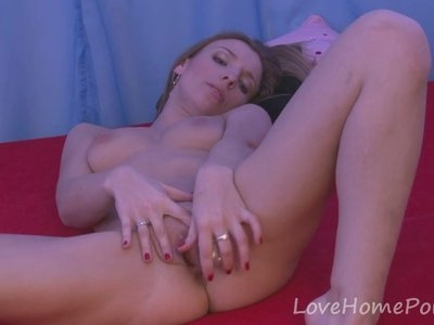 Stunning girlfriend plays with her shaved pussy