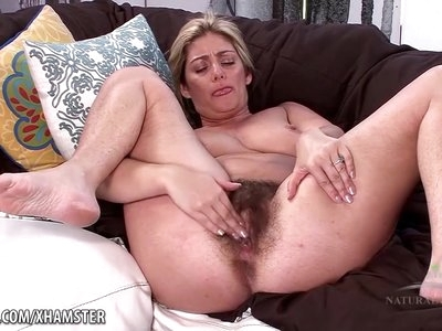 Alicia plays with her horny mature bush