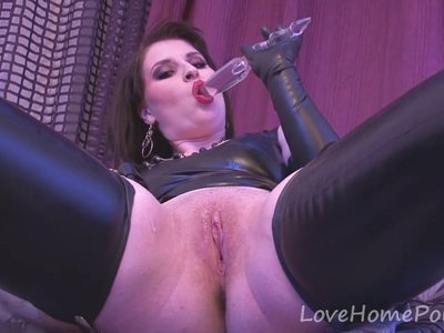 Latex babe enjoys her see through dildo