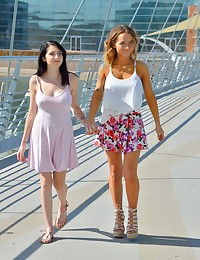 As these girls are real life friends, and Lexi introduced Charlotte to FTV -- I brought up the idea that they should do a girl-girl shoot, even though they've never been that way with each other before. They were friends in high school, though went in totally different directions in life, where Lexi went to work in a department store, as a quiet, recluse type of girl, and Charlotte became that sporty type with a very extroverted personality. FTV has reunited them again, and its pretty sweet to see them get frisky with each other for the first time. The girl-girl part wasn't as lengthy as I would have liked it however, because Lexi had to get back home earlier, and I didn't have enough time to get a full adventure shoot of them together (Lexi comes back a week later for her own shoot). Even outfit-wise, notice how different their styles are. Lexi had Lia put makeup on her, making her look somewhat different from her previous shoot (Lexi doesn't know how to put on makeup). What really stands out though is how much bigger Lexi's breasts have become -- they're swollen huge now! No... she's not pregnant, but her breast size does fluctuate. She also mentioned that all the females in her family have huge breasts, and seem to grow till they're in their 20's. So we started on location at a popular biking spot, and the girls, now used to flashing, expose their breasts and get touchy-feely with each other for the first time. They'd never even kissed before, so it was all new to them. Countless bikers saw them half-naked, so after getting decent photo & video, we headed home. There, I gave them some direction as to what to do, but beyond that I let them do their thing, touching, tasting, kissing, and playing with each other's breasts. I knew Lexi had a secret crush on Charlotte, and you can see it in the video (and she expresses it later on). Charlotte on the other hand, is all about having fun, and being her spunky self on camera. Once they got to oral sex, it was interesting 