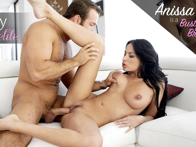 Busty French beauty Anissa Kate enjoys the way her big boobs jiggle and finds that it's hard to stop playing with them. Wearing her boyfriend Chad White's work shirt to frame her huge jugs, she caresses and jiggles her nipples to diamond hardness and slides her hands all over her smooth skin. When Chad arrives, she greets him with her bazangas hanging out and just a thong covering her lush pussy.Dragging Chad in by the hand, Anissa leads him to the couch and shoves him down. He's all hands as he strokes her soft body while she returns the favor with a focus on his hard cock. Peeling off her skimpy clothes, Chad reveals Anissa's landing strip twat and spreads her out in a beautiful buffet. Leaning forward, he presses open-mouthed kisses to the heart of Anissa's pleasure. He then settles in for a genuine pussy feast. After feeling Chad's fingers buried deep inside her, Anissa can no longer contain her deep hunger. She presses her lover back on the couch and whips out his hardon, wrapping her sweet mouth around the tip to sample her treat. Then she dives in, taking his big dick in as deep as she can. Then she presses her breasts together in a channel that is ripe for him to fuck, much to his delight.Laying back on the couch, Anissa lifts one leg high into the air so that Chad can have easy access to her slick snatch. He slides in all the way to the hilt and then starts moving. He eventually ends up spooning behind her, his hands cupped beneath the bounty of her breasts so the he can enjoy the way they quiver as he screws her.Rearranging their position so that Anissa is riding her personal steed, she rocks her hips back and forth in a sensual rhythm. Her jugs continue to bounce as she works her lush body up and down. Propping one foot on the couch, she changes her angle of penetration to hit exactly the right spot and then keeps jiggling.Relocating to the carpet, Anissa settles on her hands and knees with Chad behind her. He takes her from behind, working her so hard th