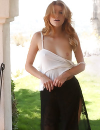 Arya Fae pokes out of her shirt with her hard nipples
