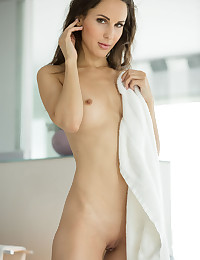 Wrapped in nothing but a tiny towel, Lulu is getting ready for a bath. But suddenly something else catches her eye, and it makes her feel super hot. As she strokes her nipples, she gets aroused and sends her fingers south. Plying through her wet pussy, she stirs and moans on the rug. Then out it comes - a sex toy like you've never seen. Impossible to describe, let's leave it at this - not only is it crystal clear and filled with a mysterious substance, but it's the biggest insertion device we've ever seen. And boy does she love it! This is one huge self-fuck session, so if you like big size in a small tight girl, happy birthday!