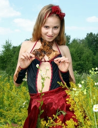 Admirable teen beautie undressing and showing her perky tits and hairy pussy in a field.