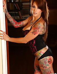 Stunning tattooed Alluring Vixen babe Nikki N teases in her sexy floral lace corset and skimpy panties