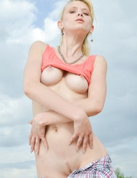 Amazing blonde girl with excellent breasts undressing and showing trimmed pussy outdoors.