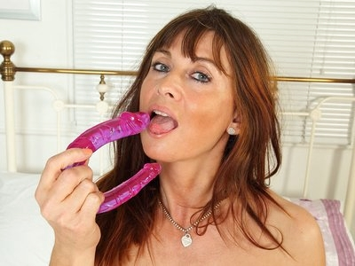 British milf Lelani gets naughty with a sex toy