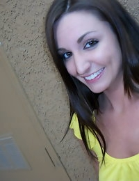 Cute girlfriend takes selfshot pictures out on the patio for her boyfriend
