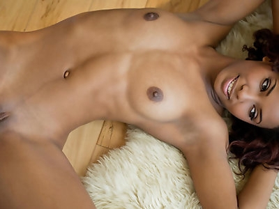 Spencer is without a doubt one of the most beautiful women on the Babes roster, her toffee colored skin, sets the stage for a dazzling smile and eyes you could drown in. Shyly posed and softly lit, this scene is truly one of the best! Watching Spencer caress her breasts and fondle her pink slit, nestled in the dark cinnamon folds of her lady cleft, is ultra-erotic and guaranteed to raise your bar. Probably the best solo performance we've seen yet.