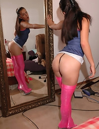 The Brat's pink and black thong doesn't hide much of that hot ass!