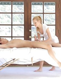 Masseuse seduces male client.