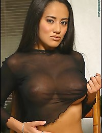 It was just a happy coincidence that we found ourselves with a new Asian standout, Tera, in the same month as Lelani makes a stunning double performance. These two Asian beauties have a lot in common, that's for sure. Well, besides being Asian and beautiful, they both have awesome breasts and great bodies. Tera is a rare discovery we had to unveil here. Her big D-cup breasts are so delectable when viewed through her black netted top. Check out the hot debut of a major Dream Doll in Tera Busty Asian Babe