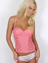Busty blonde vixen Alysson teases in a tight lowcut pink corset that barely contains her big tits