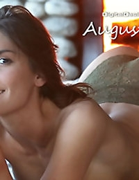 August Ames undresses in front of a warm fire