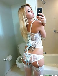 Curvy blonde babe with tattoos models some lingerie and has her pussy fucked hard