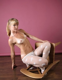 Petite blonde Amber is hot when posing in her stockings