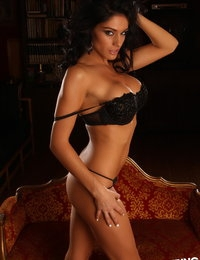 Alluring Vixen Amanda loves to tease in her skimpy matching black bra and g-string