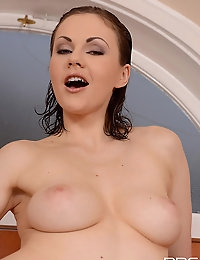Tina Kay toying her self in the bathtub with a blue dildo