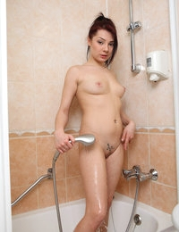 Sexy beauty Selma loves to play in her warm shower