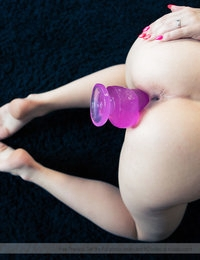 The big pink toy seemed to be too much for her tight pussy, but with her mouth wide open she slowly maneuverd the pleasure stick deeper and deeper inside her soaking snatch.
