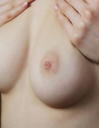 Nancy A is very natural and confident showing off her lithe naked body.