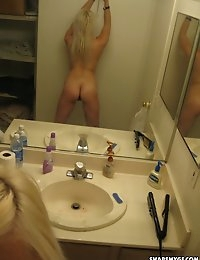 Blonde perky teen takes selfshot pictures for her boyfriend