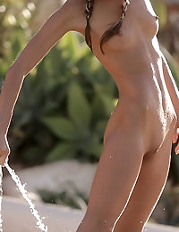 Hot cutie gets a fun water treatment outdoors