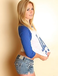 Blonde tease Ashley Vallone shows off in a LA shirt and super tight jean shorts