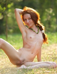Playful and skinny Kesy enjoys the outdoors while completely nude