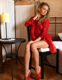 Ginny the sexy lady in red gives a real tease while removing clothes on the chair