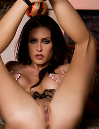 Jessica Jaymes plays with her pussy on a leopard sofa.