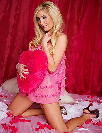Tasha Reign is feeling the love as she slips out of her pink lingerie.