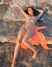 Reneta a rare beauty basking in the sunset nude with her orange cape