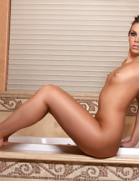 Tiffany Tyler likes to get all wet and soaped up in the bathtub.
