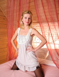 Nubile blonde angel Yara gets down naked under the pink bedroom veil