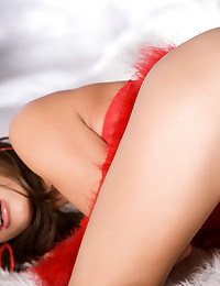 Renee Diaz is caught in a winter wonderland in her sexy red lingerie.