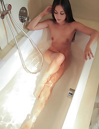 After a warm wet bath Iwia jumps her mans bones for a horny blowjob and a wild sensual romp in her landing strip pussy