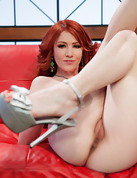 Red head babe Elle Alexandra gets a bit frisky on the couch.