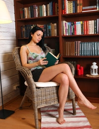 Studious brunette Macy give striptease in the chair after reading a book