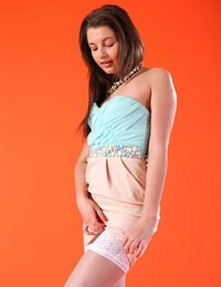 Cute Liona in blue and peach dress adorned with white nylon stockings