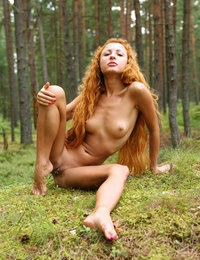 Redhead Nancy in the woods posing nude and frolicking in the grass