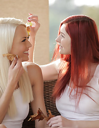 Horny lesbians Kattie Gold and Lena Love go to town licking and finger fucking each others juicy landing strip pussies