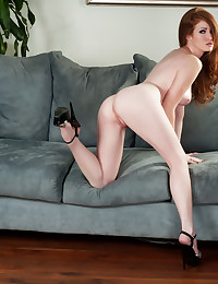 Beautiful red head Nikki Rhodes exposes her beauty and her ginger snatch.