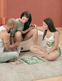 Athina, her best friend Valentina Nappi, and her lover Mike are enjoying a lazy afternoon of board games when Mike is overcome with a sudden fit of lust. He kisses Athina deeply, and this earnest display of passion even gets Valentina excited. Mike and Valentina explore Athina's body, gradually bringing her closer and closer to orgasm as they undress. Valentina and Athina take turns with Mike's hard cock, sucking, stroking, and taking it deep in their wet pussies until their bodies are quaking with body rocking orgasms. Finally, Valentina and Athina jerk a load of Mike's hot sticky cum all over both of their smiling faces, and their afternoon of board games is long forgotten.