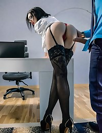 Nikolas could barely keep a professional attitude when his secretary Sheri delivered her report to his desk in a black pencil skirt that showed the full curve of her hips and plump ass. While Nikolas looked over the papers, Sheri unbuttoned her blouse and gave him a peek at her breasts. Once they locked lips and started making out, Sheri and Nikolas followed their passion to a bout of hot sex on the boss's desk. Watch how Nikolas bent Sheri over and licked her pussy and ass from behind, then slipped in his cock and humped her hard. The sex was passionate, urgent, and deeply satisfying.