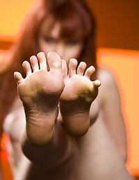 Justine Joli shows off her sexy toes and sexy porcelain skin.