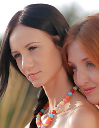 Two hot girls get all wet and slippery with oil