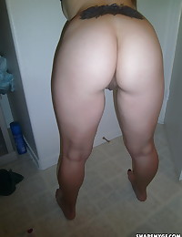 Perfect petite girlfriend takes selfshot pictures for her boyfriend in the bathroom at school